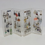 Assortment of Earrings and Stand