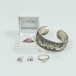 Sterling Silver Rings with Silver Coloured Earrings and a Cuff Bangle