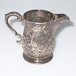 Georgian Irish Sterling Silver Jug with Repousse Floral Scroll Decoration