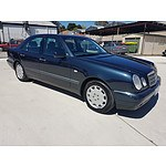 1/1999 Mercedes-Benz E430 Elegance W210 4d Sedan Blue 4.3L