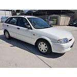 3/2000 Ford Laser LXi KN 5d Hatchback White 1.6L