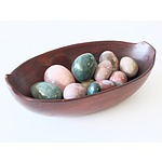 Collection of Decorative Stone Eggs in a Carved Bowl