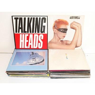 Collection of Records, Including Warren Zevon, U2, Split Enz, and More