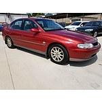 6/2001 Holden Calais  VX 4d Sedan Red 5.7L