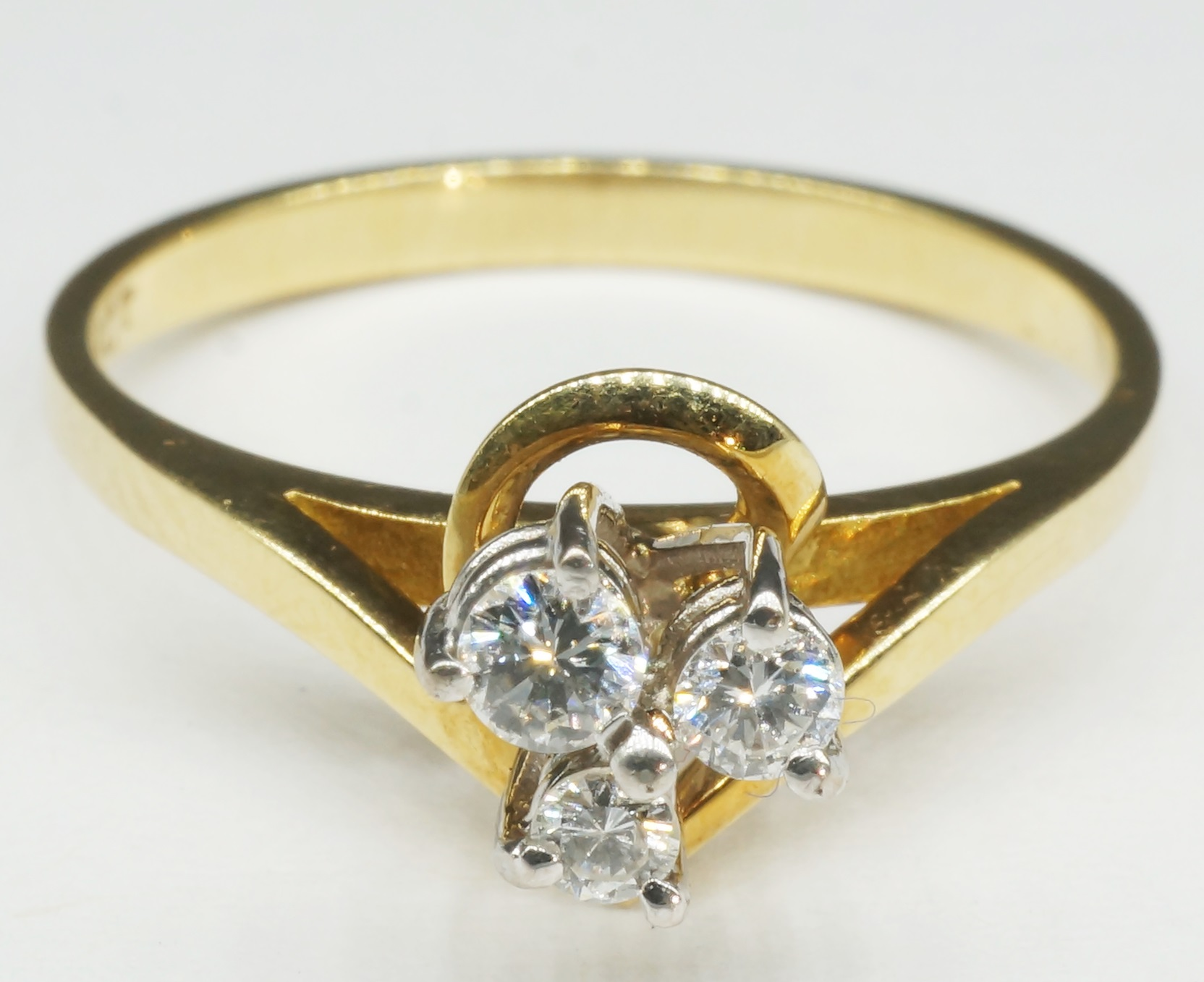 '18ct Yellow Gold with White Gold Three Claw Setting with Three round Brilliant Cut Diamonds'