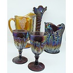 Group of Carnival Glass Including Two Water Pitchers, Two Goblets and a Vase