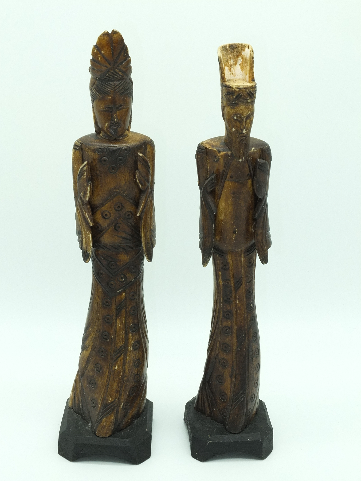 'Two Asian Lacquered Bone Carvings'
