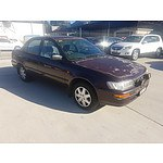 4/1995 Toyota Corolla Conquest AE102R 4d Sedan Red 1.8L
