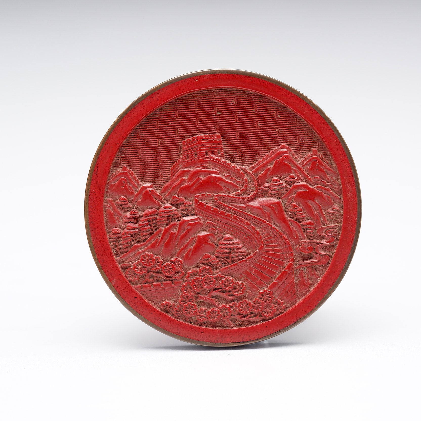 'Chinese Carved Cinnabar Lacquer Medallion with Brass Mounted Rim'