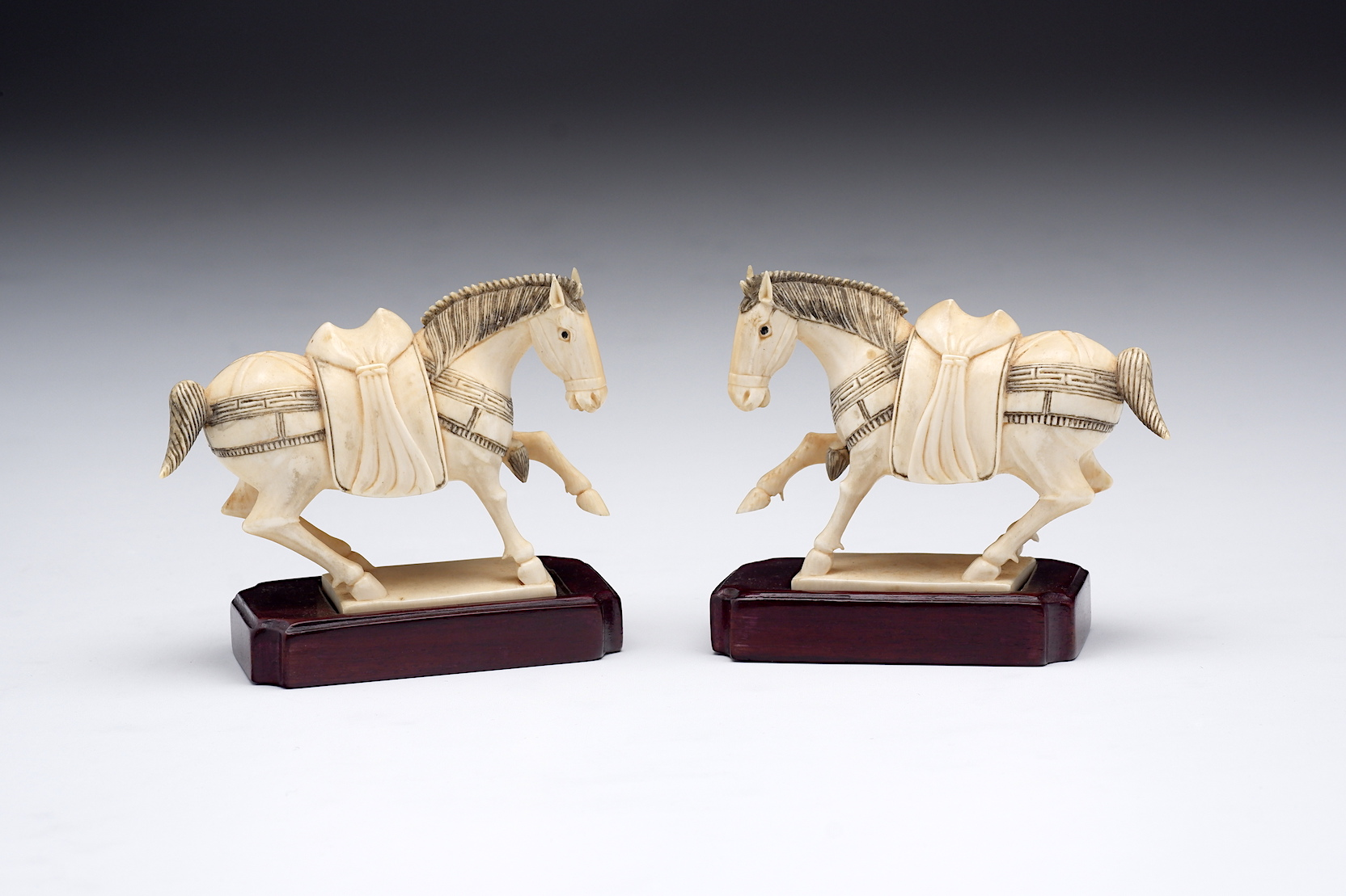 'Pair of Chinese Finely Carved and Engraved Elephant Ivory Horses on Fitted Hardwood Stands, Early to Mid 20th Century'