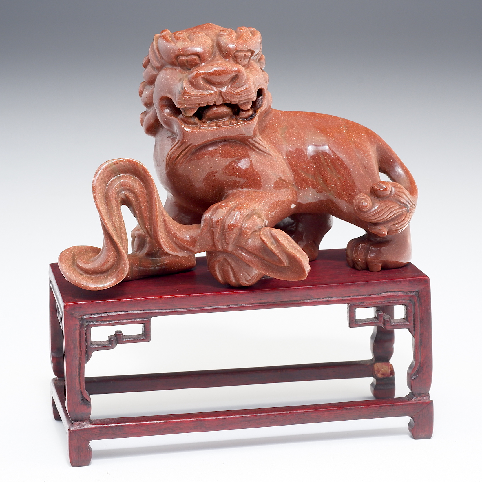 'Chinese Carved Goldstone Buddhist Lion on Hardwood Stand 20th Century'