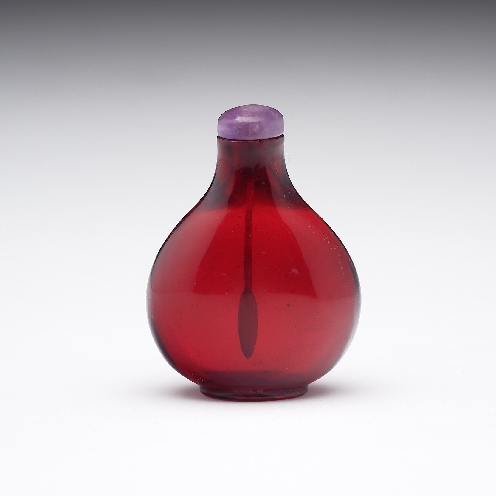 'Chinese Red Glass Snuff Bottle with Amethyst Quartz Stopper'