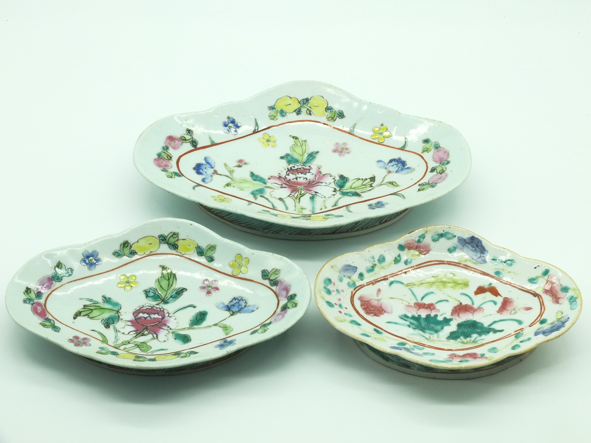 'Three Chinese Famille Rose Lobed Footed Dishes Late Qing, 19th Century'