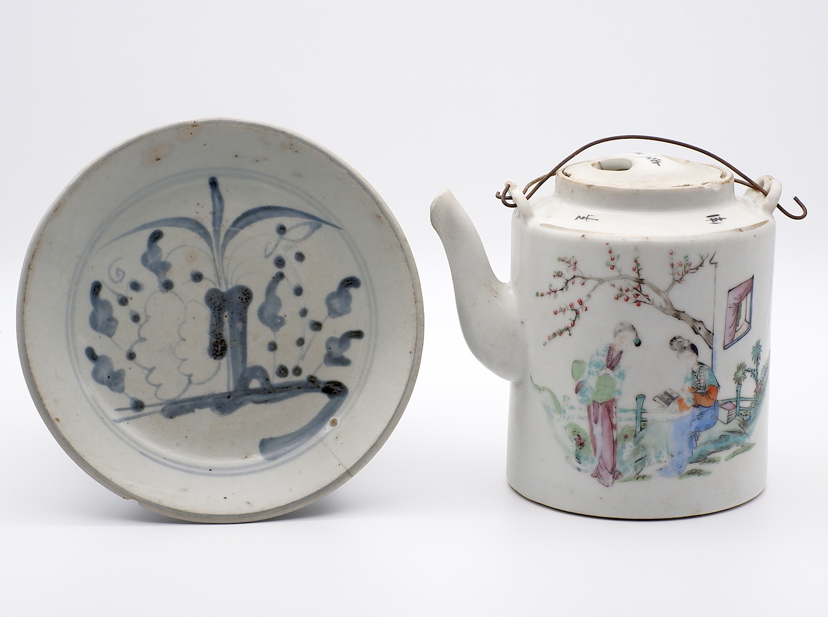 'Chinese Fujian Ware Blue and White Dish and a Republic Famille Rose Teapot Damages'