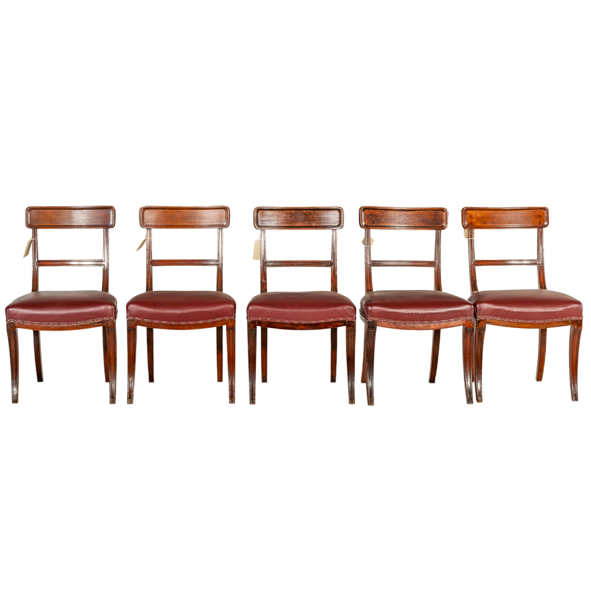 'Five Regency Period Mahogany Sabre Leg Dining Chairs with Maroon Leather Upholstery Circa 1815'