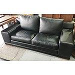 Two Tasman Three-Seater Black Leather Lounges