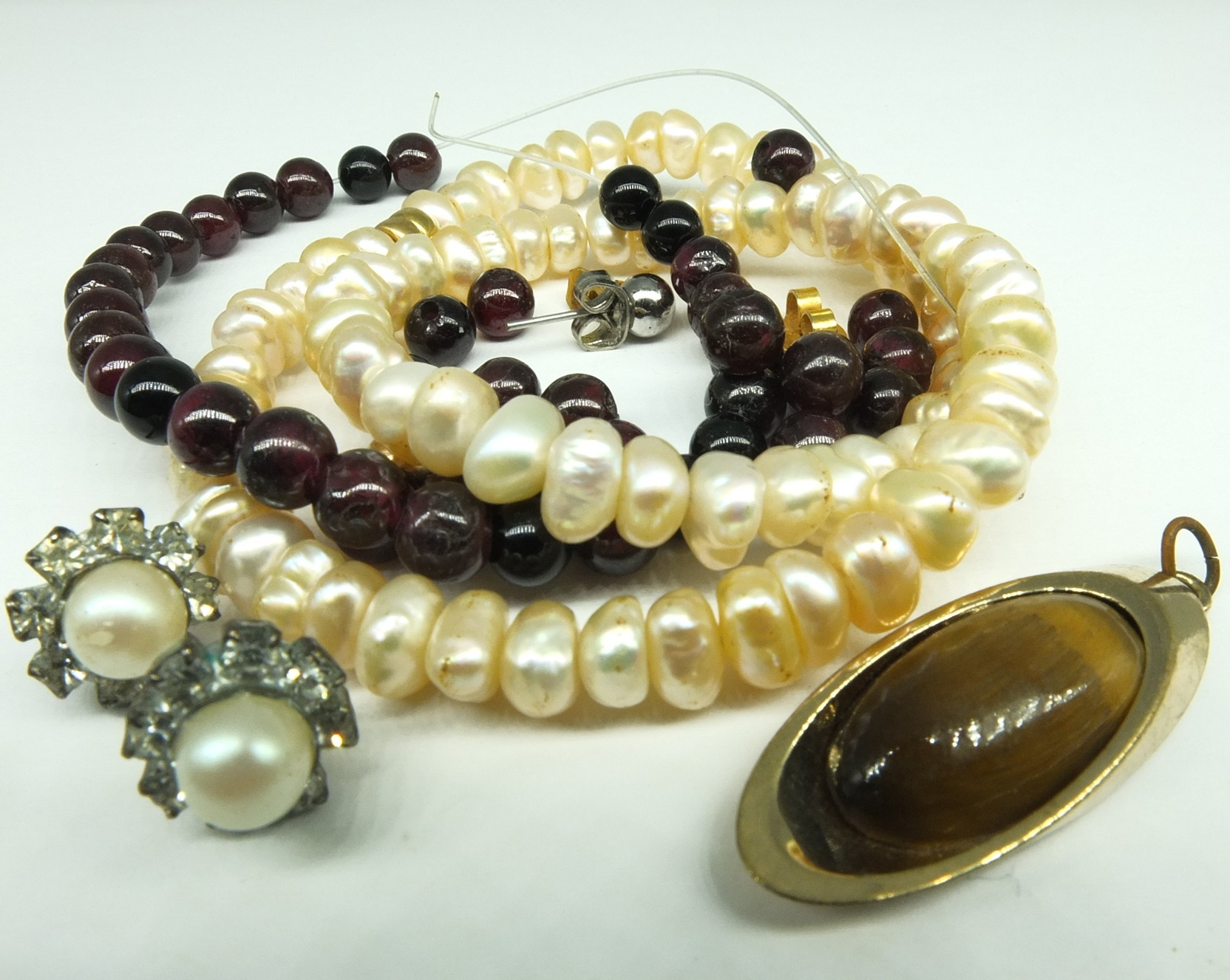 'Broken Garnet Necklace, Tiger Eye in Metal Mount and a Bracelet of Fresh water Pearls'