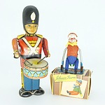 Vintage Tin Wind Up Soldier and a Schuco Turn Clown 882