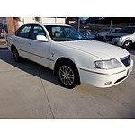 12/2003 Toyota Avalon Grande MCX10R 4d Sedan White 3.0L