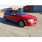 3/1999 Ford Laser LXi KN 5d Hatchback Red 1.6L