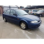 11/2001 Ford Laser LXi KQ 4d Sedan Blue 1.6L