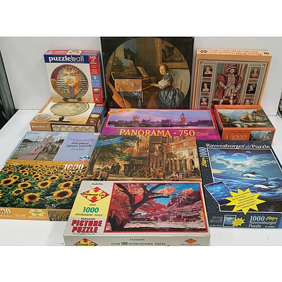 Section of Jigsaw Puzzles - Lot of 55