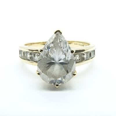 9ct Yellow Gold Pear Shaped Cubic Zirconia Ring With Channel Set Shoulder