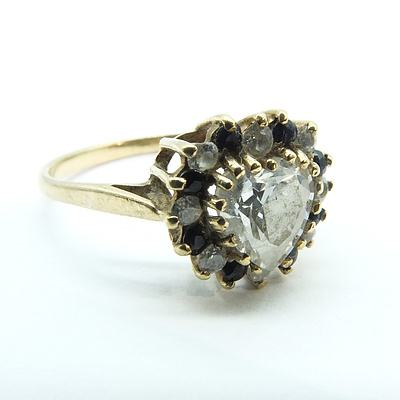 9ct Yellow Gold Heart Shaped Cubic Zirconia with round Cubic Zirconia and Dark Sapphire Surround