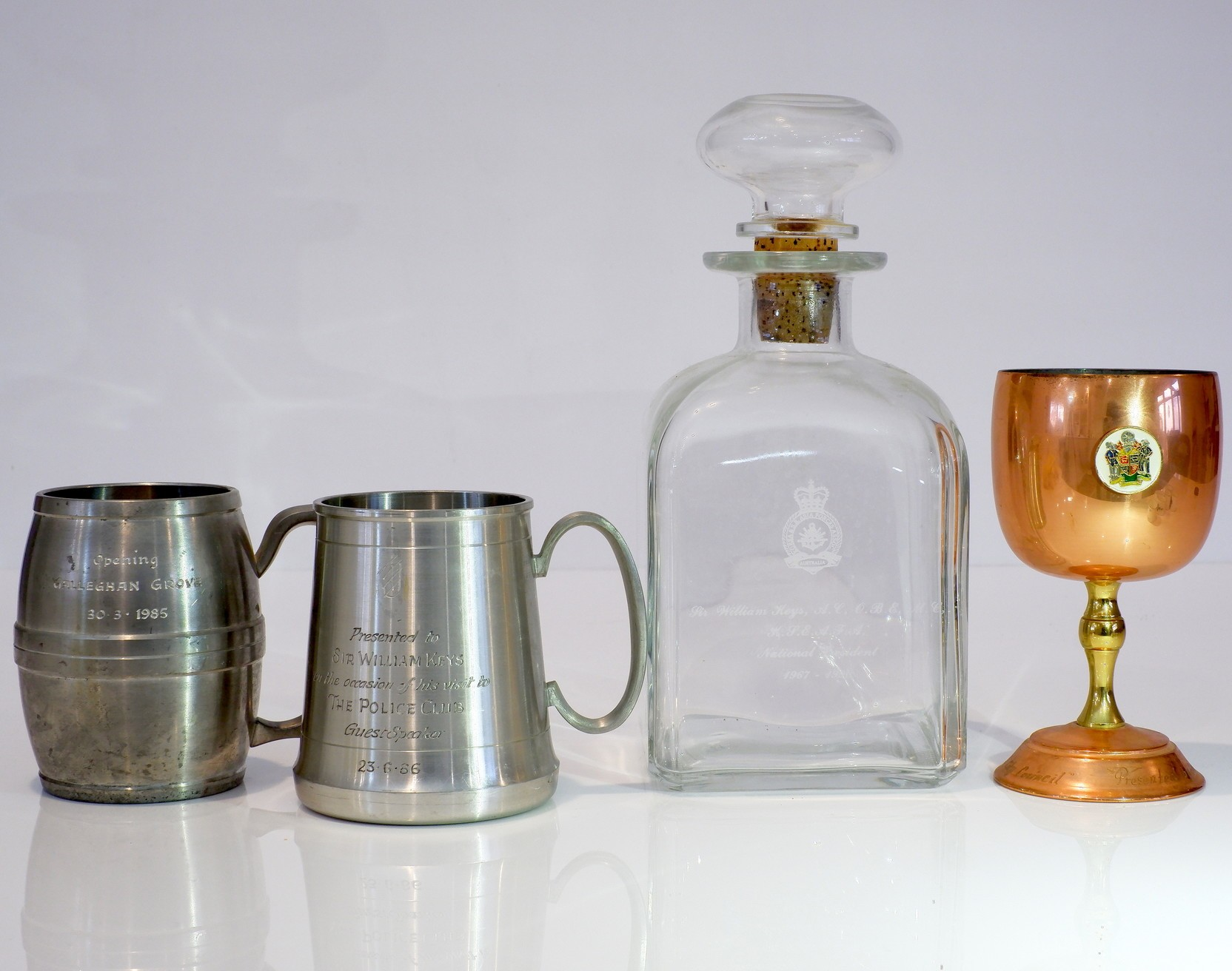 'Glass Decanter, Two Pewter Mugs and a Copped Wine Glass Presented to Sir William Keys'