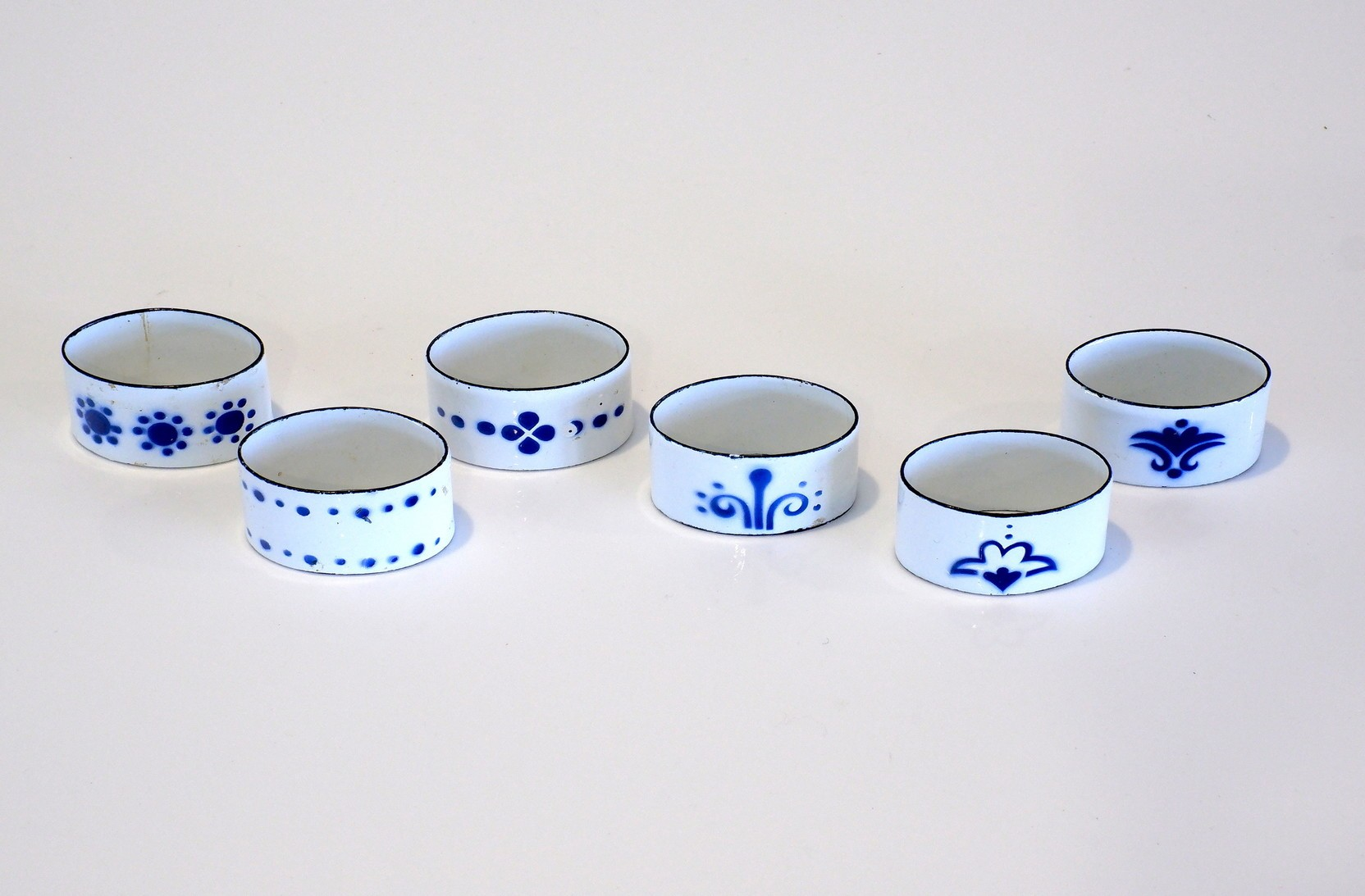 'Six Vintage Enamelled Napkin Rings'