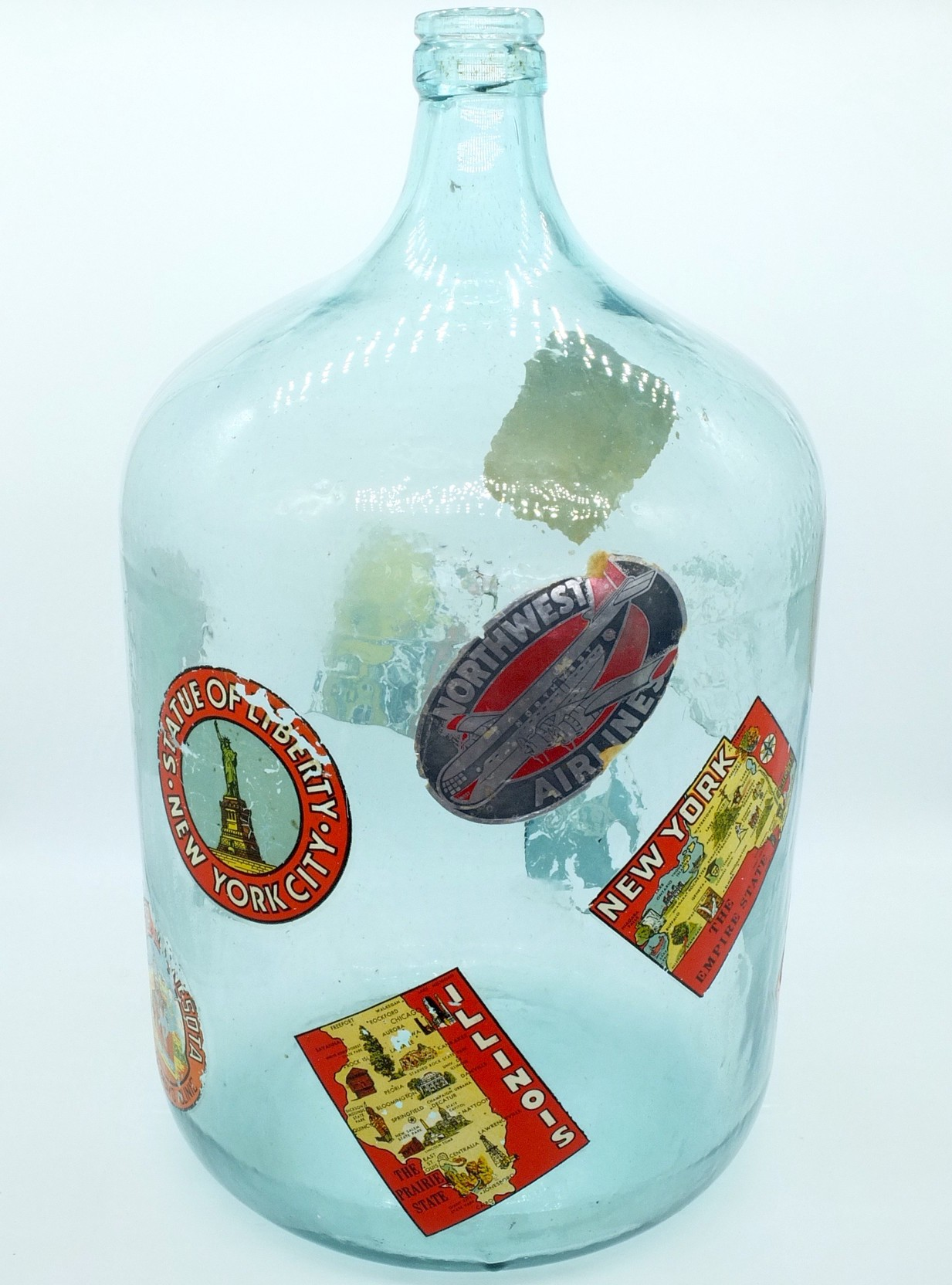 'Vintage Hand Blown Glass Bottle with Various Travel Stickers'