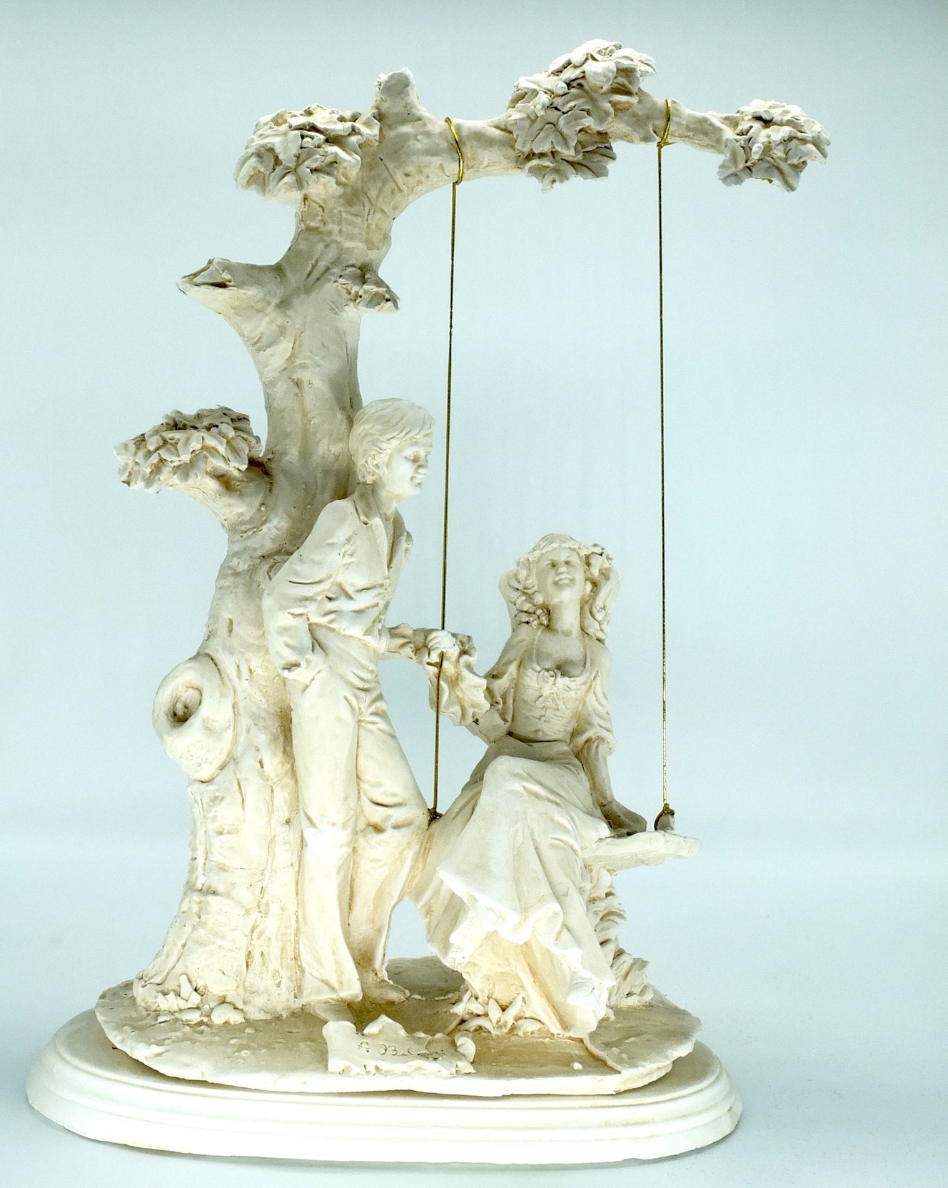 'Cast Plaster Courting Couple by a Swing after A Belcari'