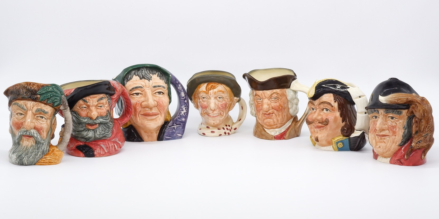 'Collection of Seven Royal Doulton Toby Jugs'