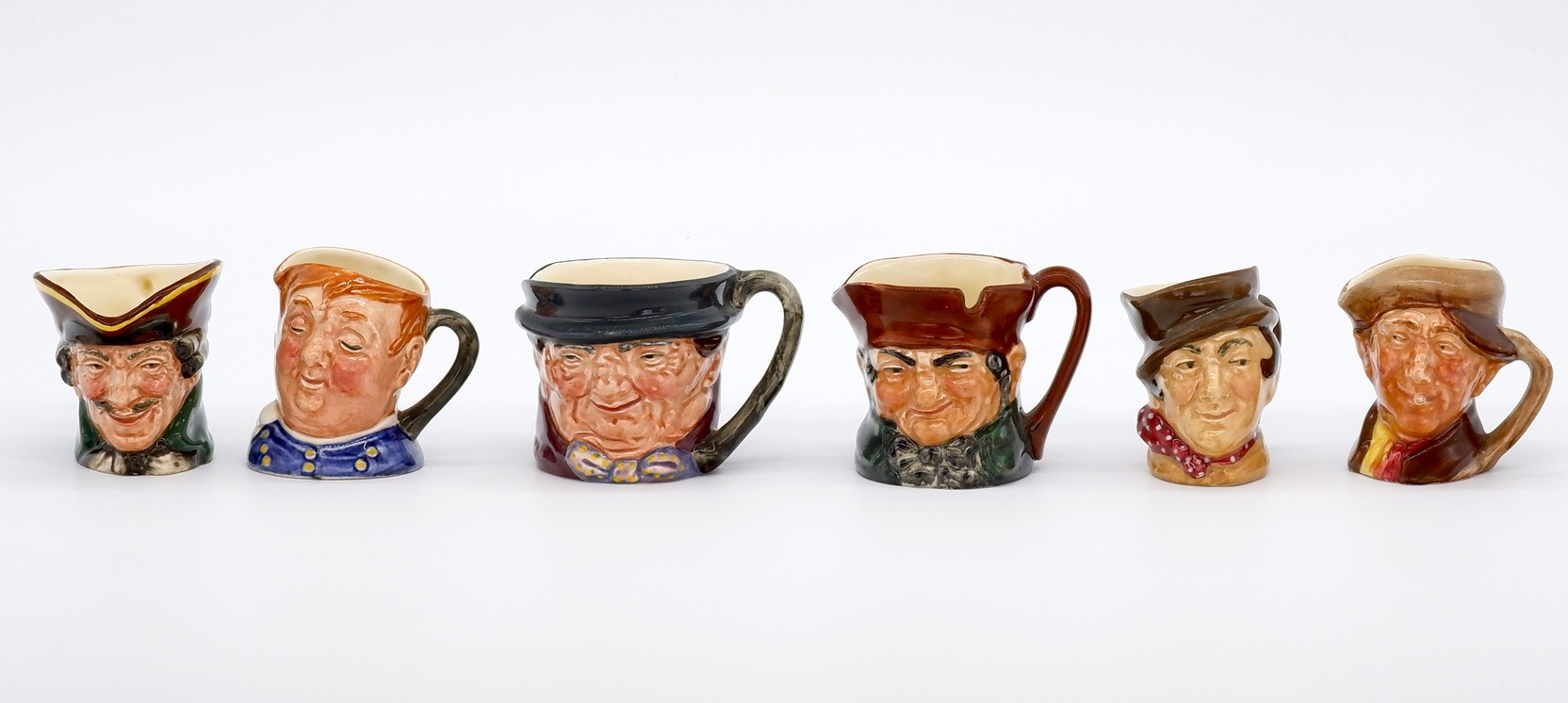 'Collection of Six Miniature Royal Doulton Toby Jugs With A Mark'