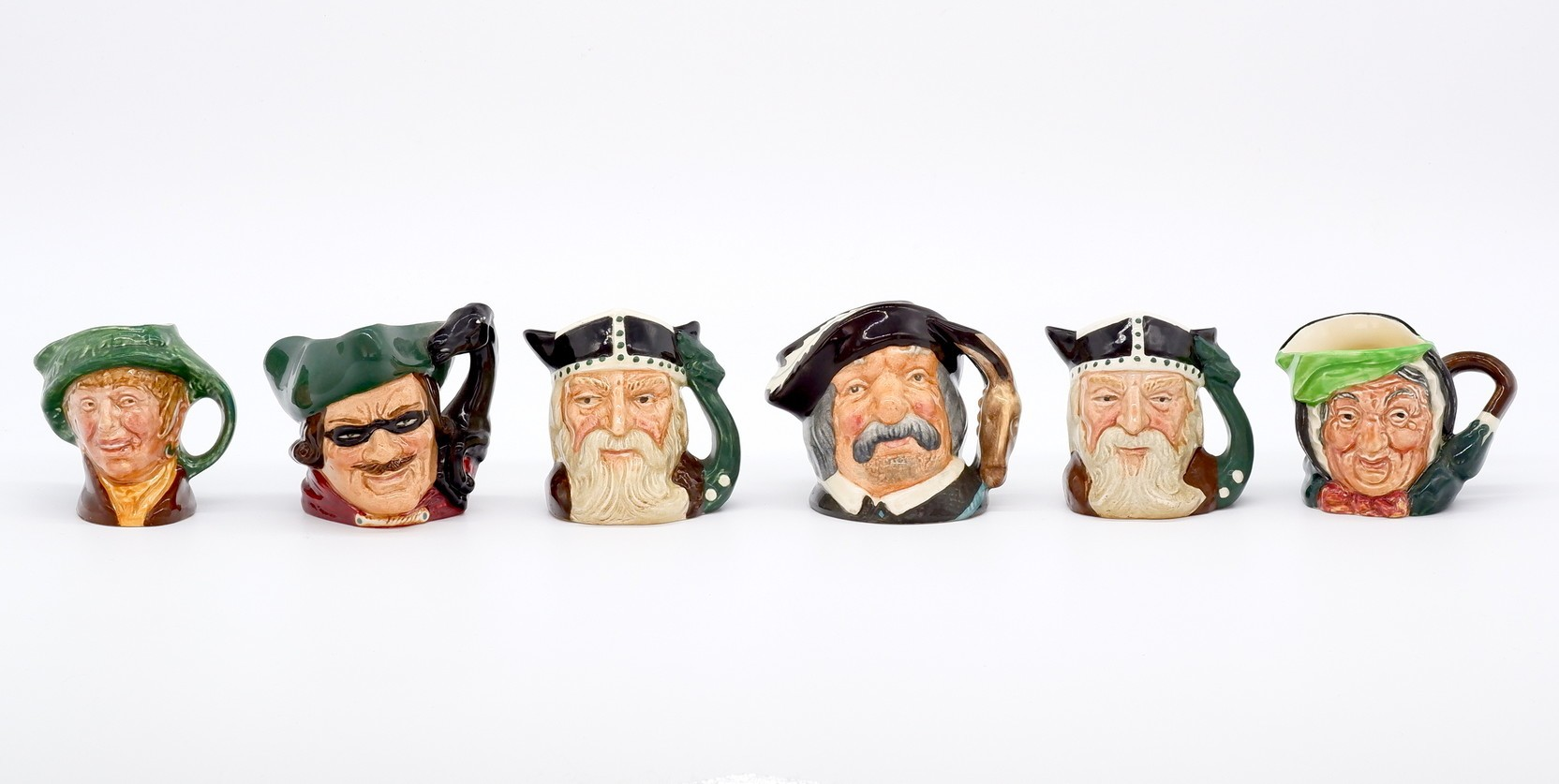 'Collection of Six Miniature Royal Doulton Toby Jugs'