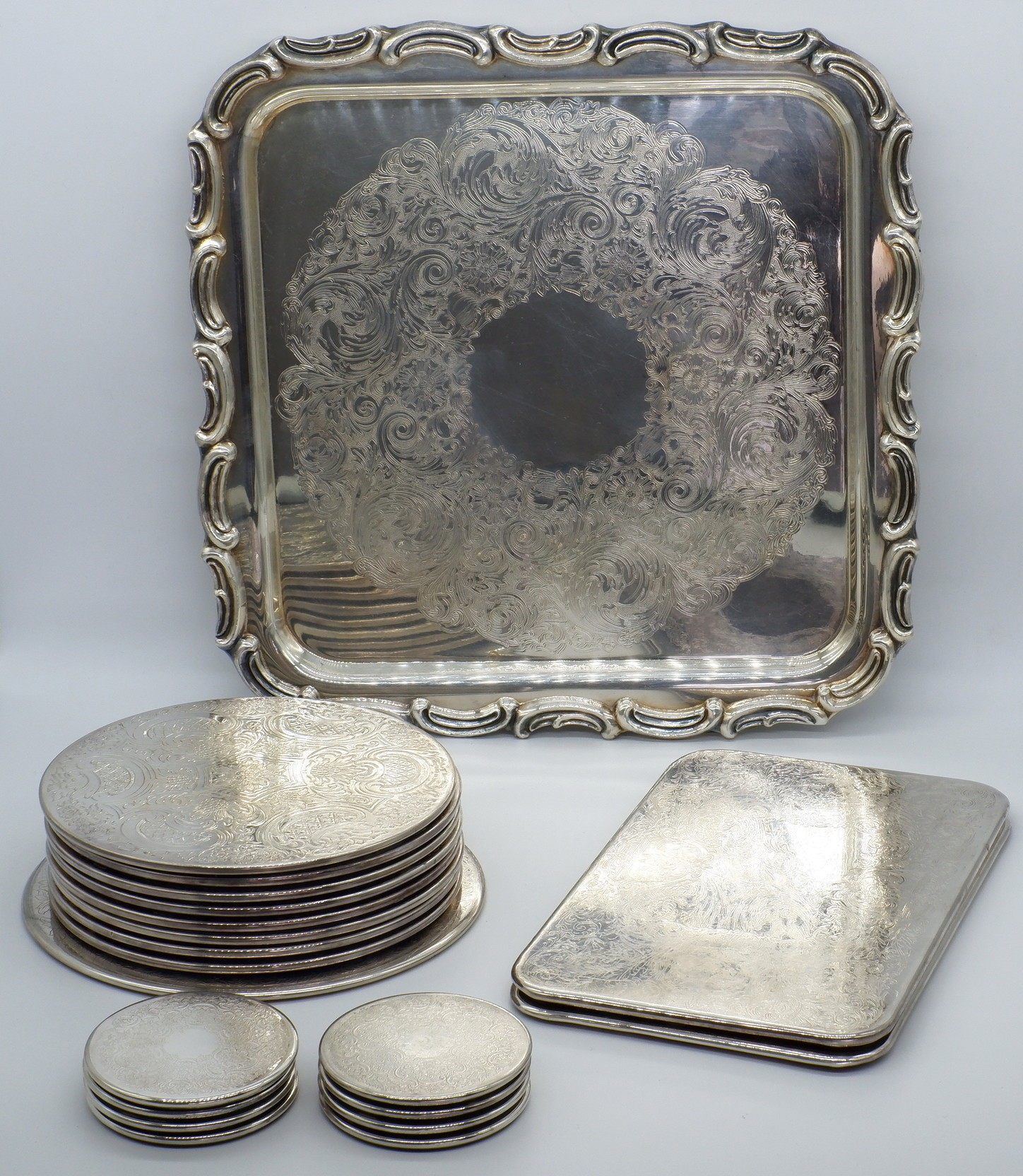 'Group of Strachan Coasters and a Galleon Silver Plate Tray'