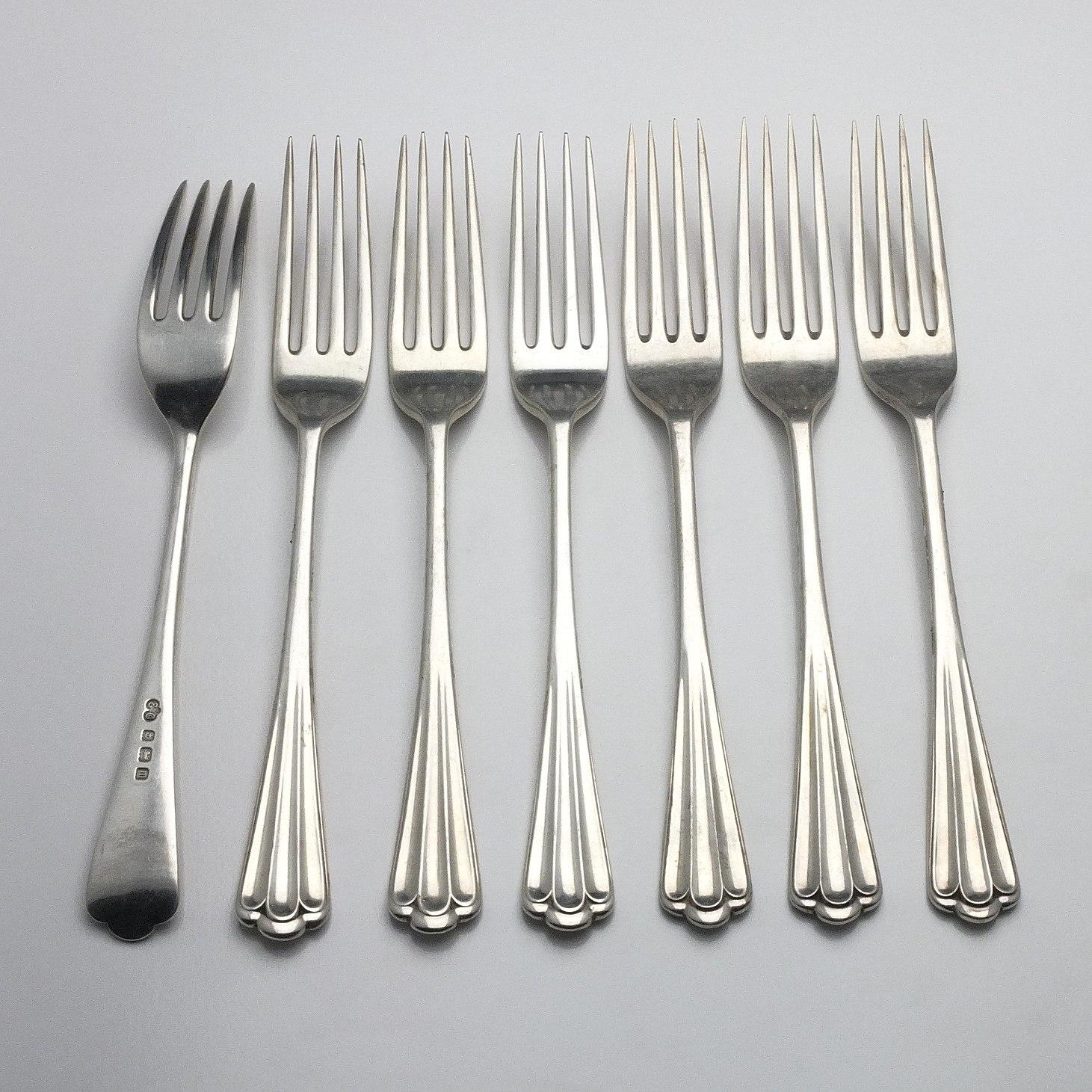 'Seven Sterling Silver Mains Forks Elkington & Co Ltd Birmingham 1911 and 1928'