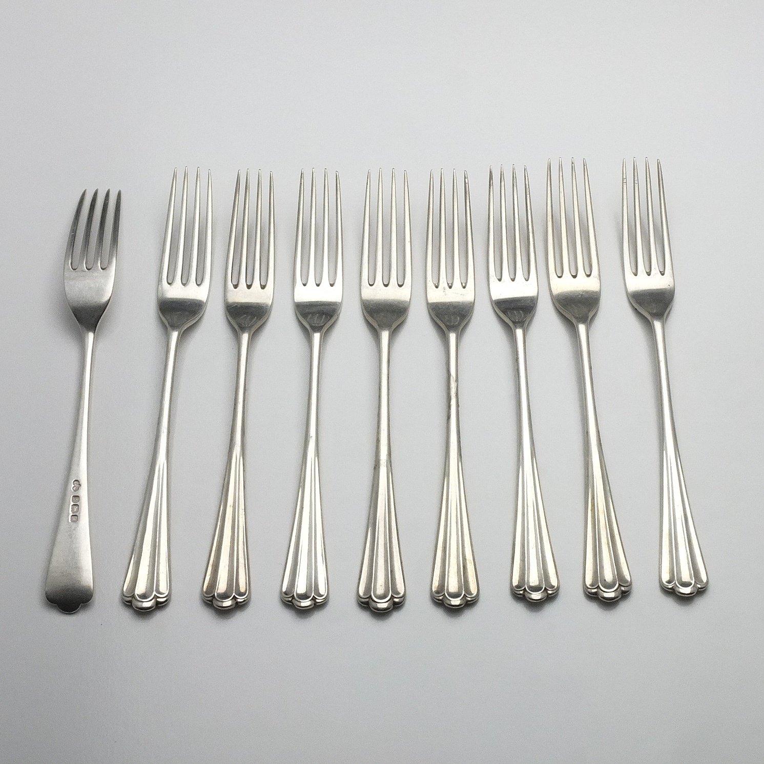 'Nine Sterling Silver Mains Entree Forks Elkington & Co Ltd Birmingham 1909 and 1928'