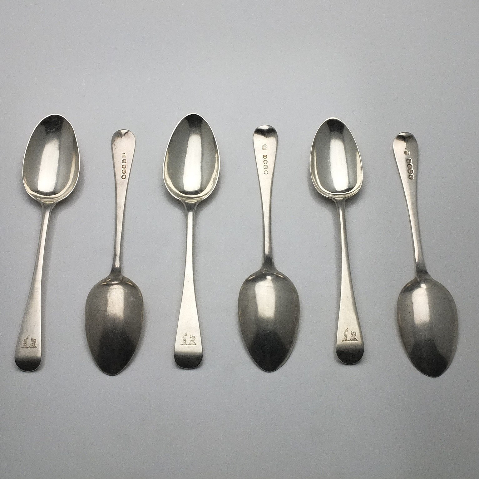 'Six George III Crested Sterling Silver Spoons Including Two William Eley, William Fearn & William Chawner London 1814'