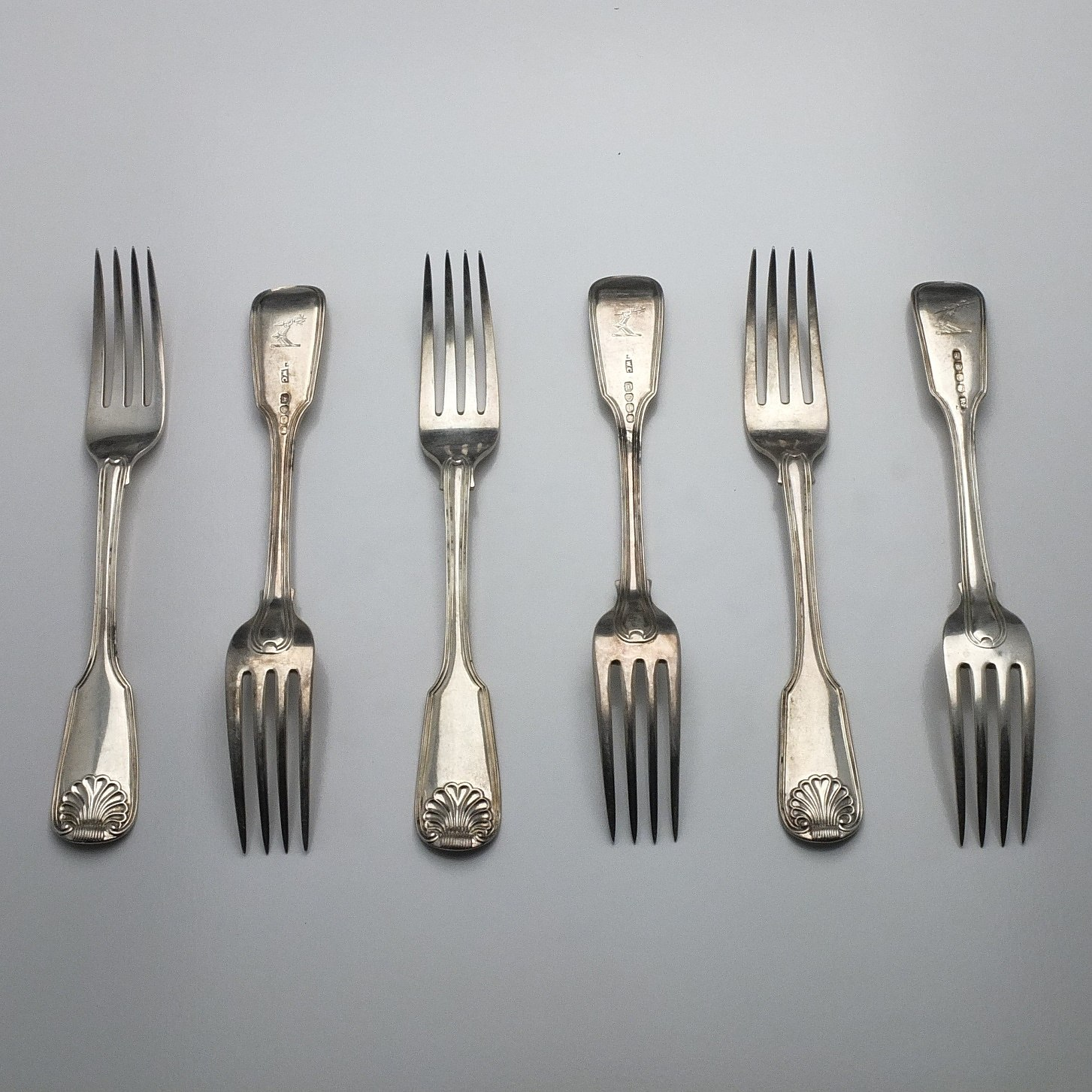 'Six Georgian Crested Sterling Silver Mains Forks, Including Four William Chawner II London 1831'