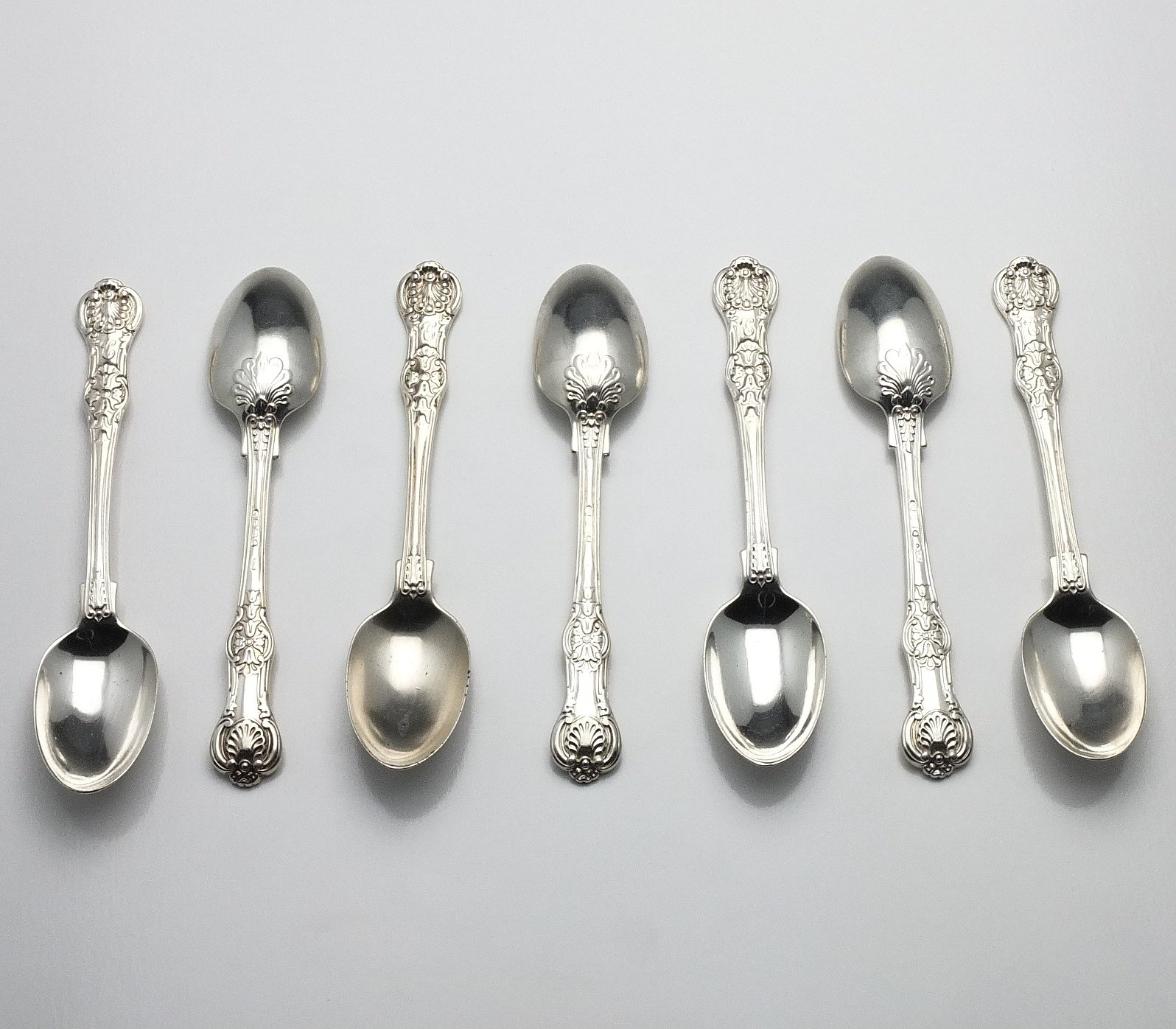 'Seven Victorian Crested Sterling Silver Kings Pattern Teaspoons Chawner & Co London 1870'