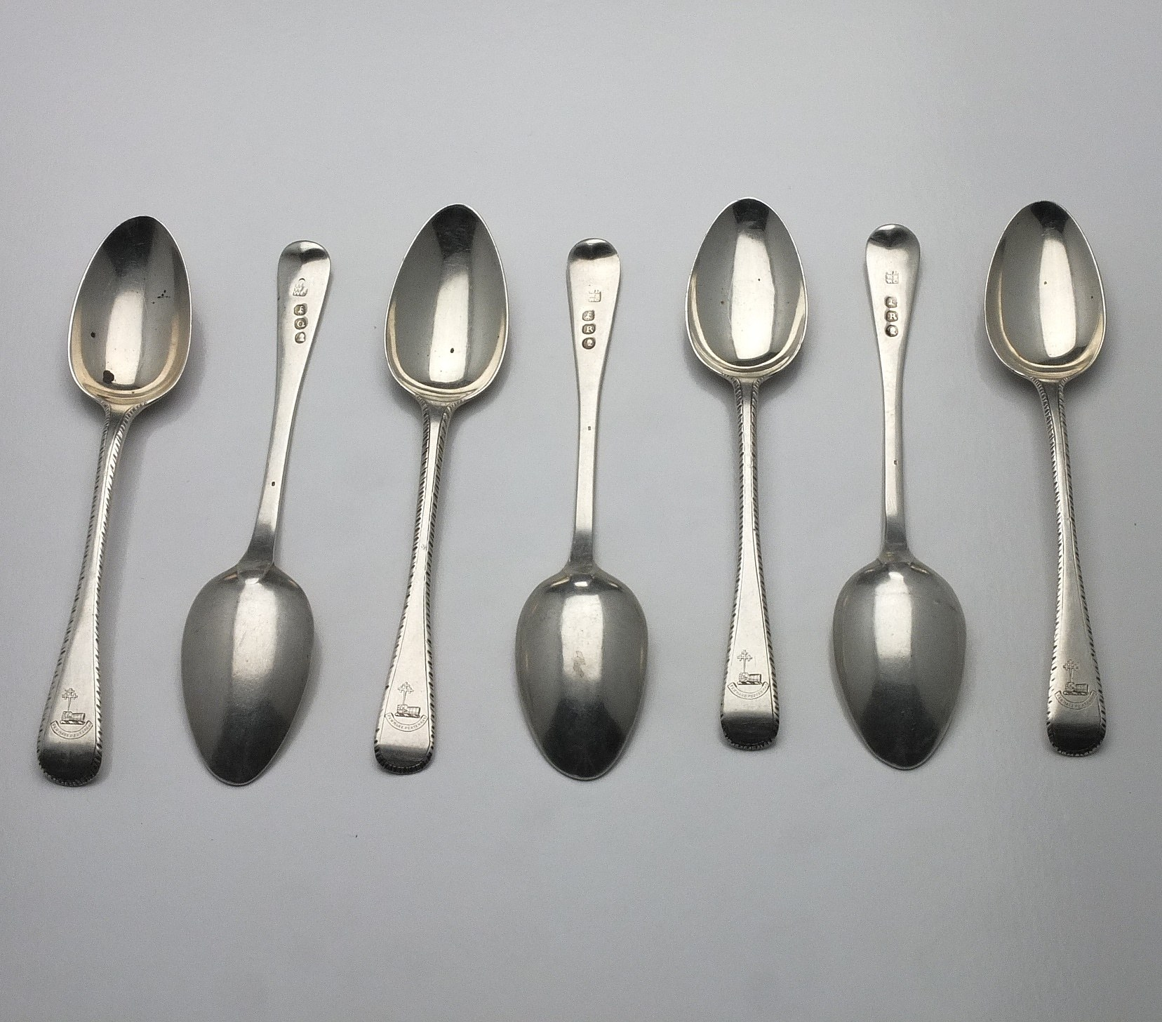 'Seven Georgian Crested Sterling Silver Bright Cut Teaspoons, Including Four William Eley, William Fearn & William Chawner London 1812'