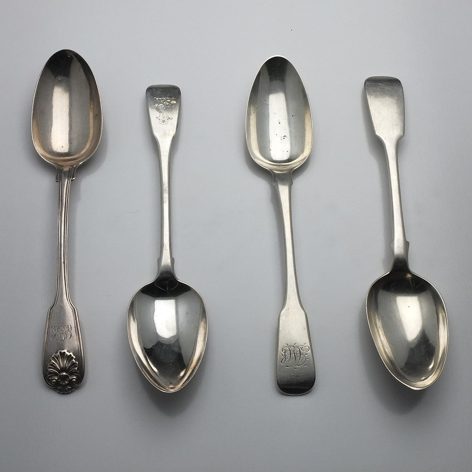 'Four Sterling Silver Table Spoons London 1808, 1815, 1825 and 1839'