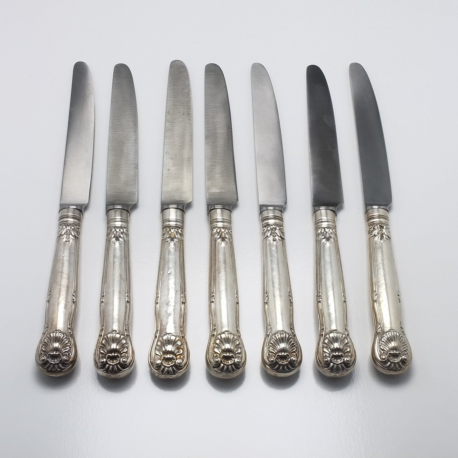 'Seven Sterling Silver Handled Kings Pattern Mains Knives London 1836 and 1841'
