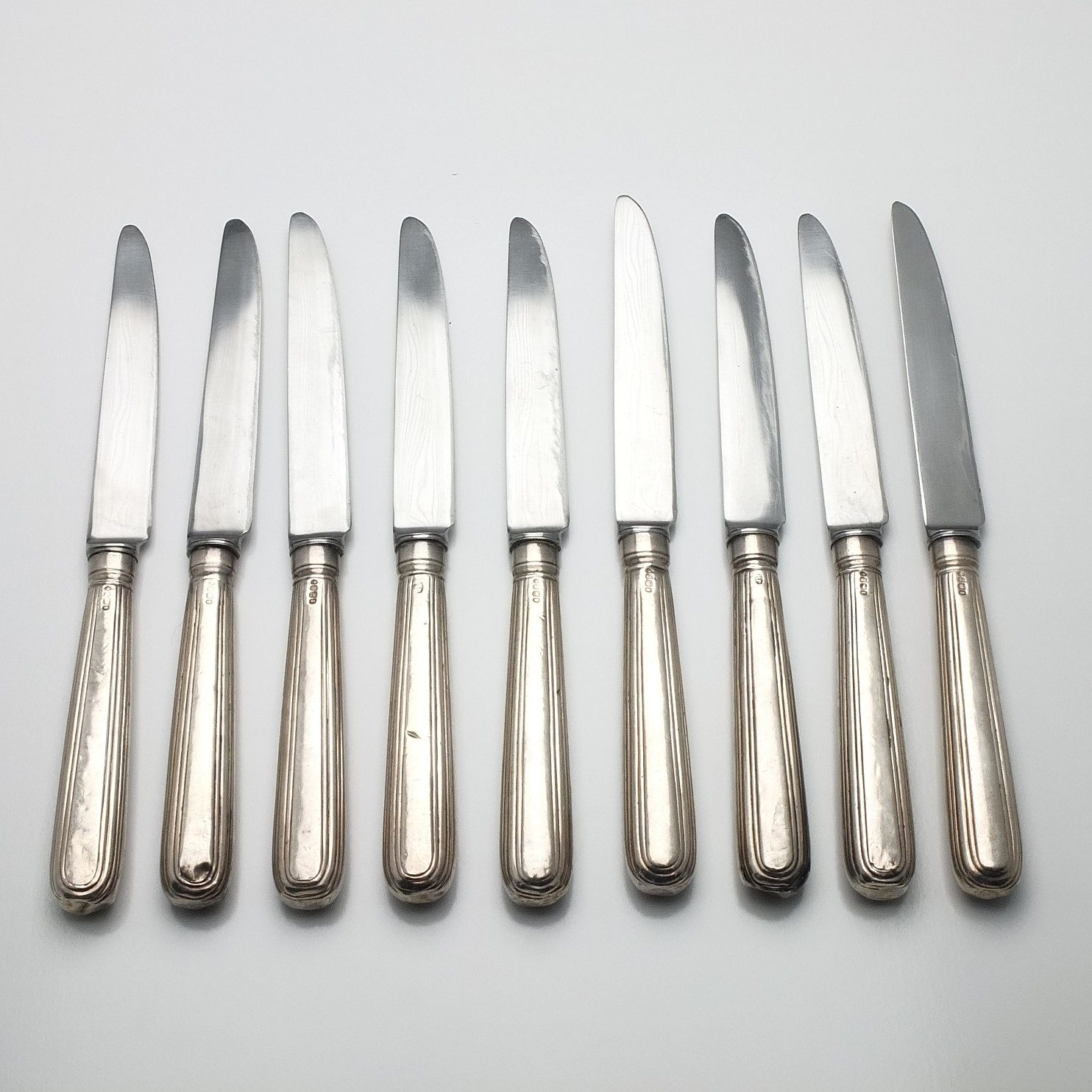 'Nine Georgian Sterling Silver Mains Knives London 1832'