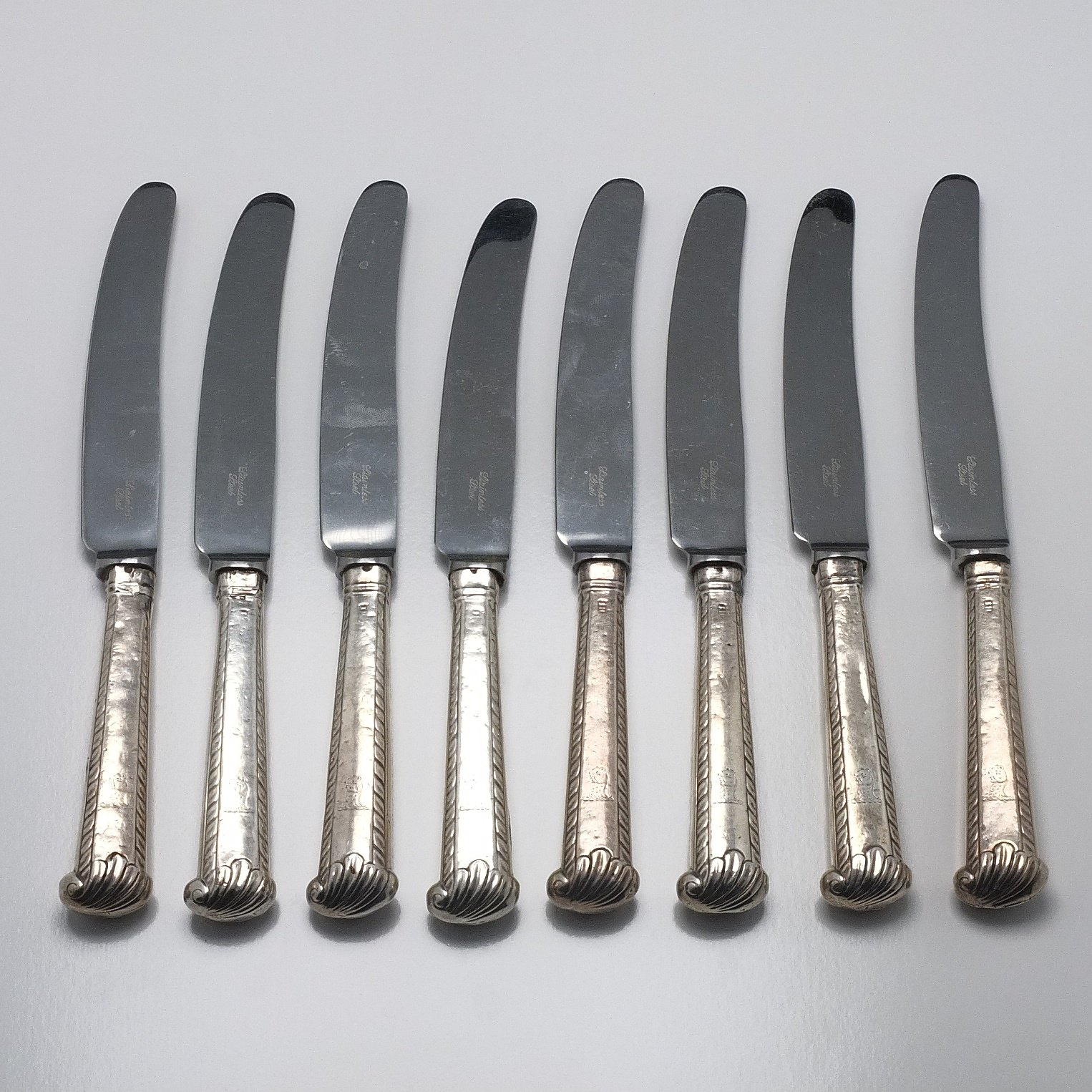 'Eight Crested Sterling Silver Handled Entree Knives'