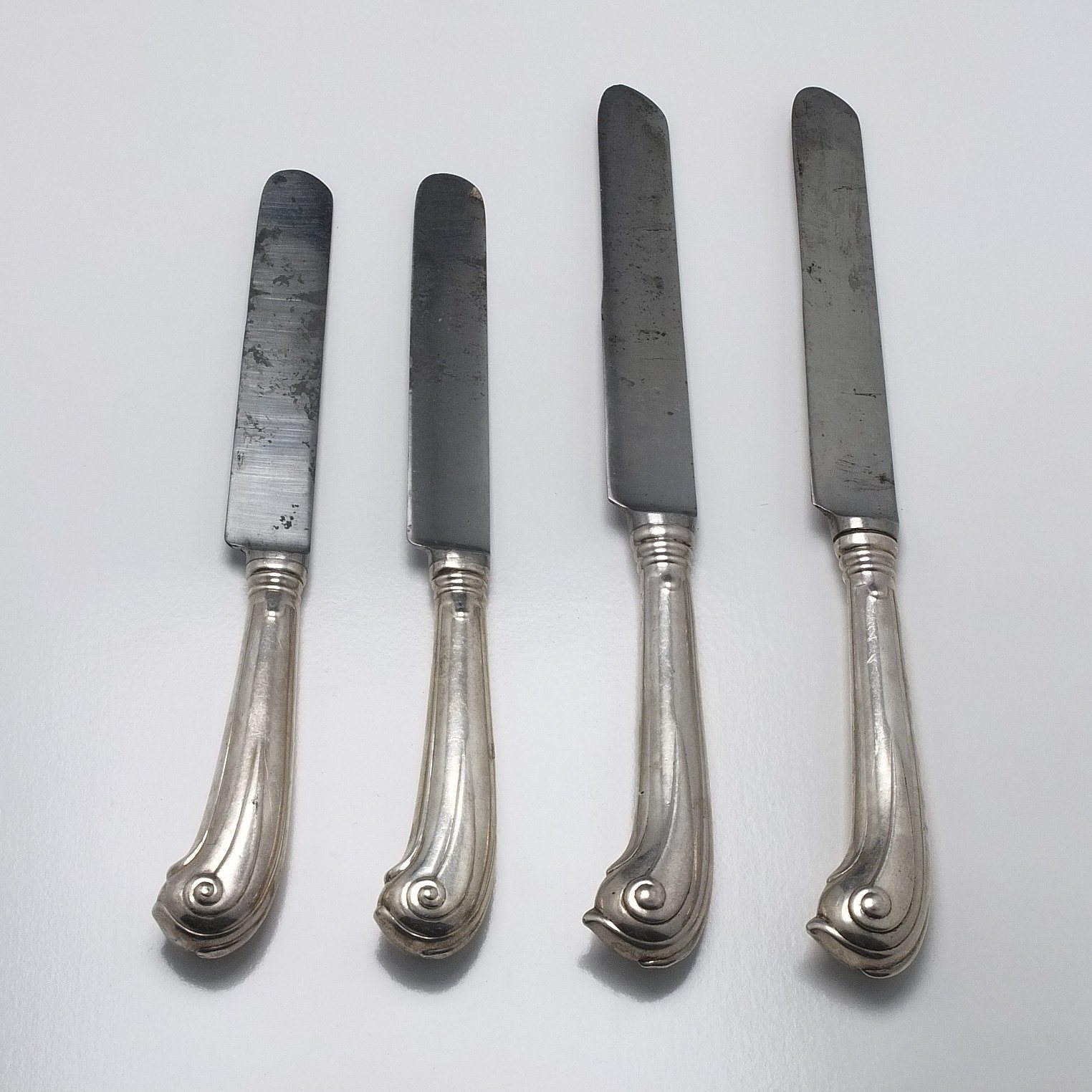'Four Sterling Silver Handled Knives Howard and Co'