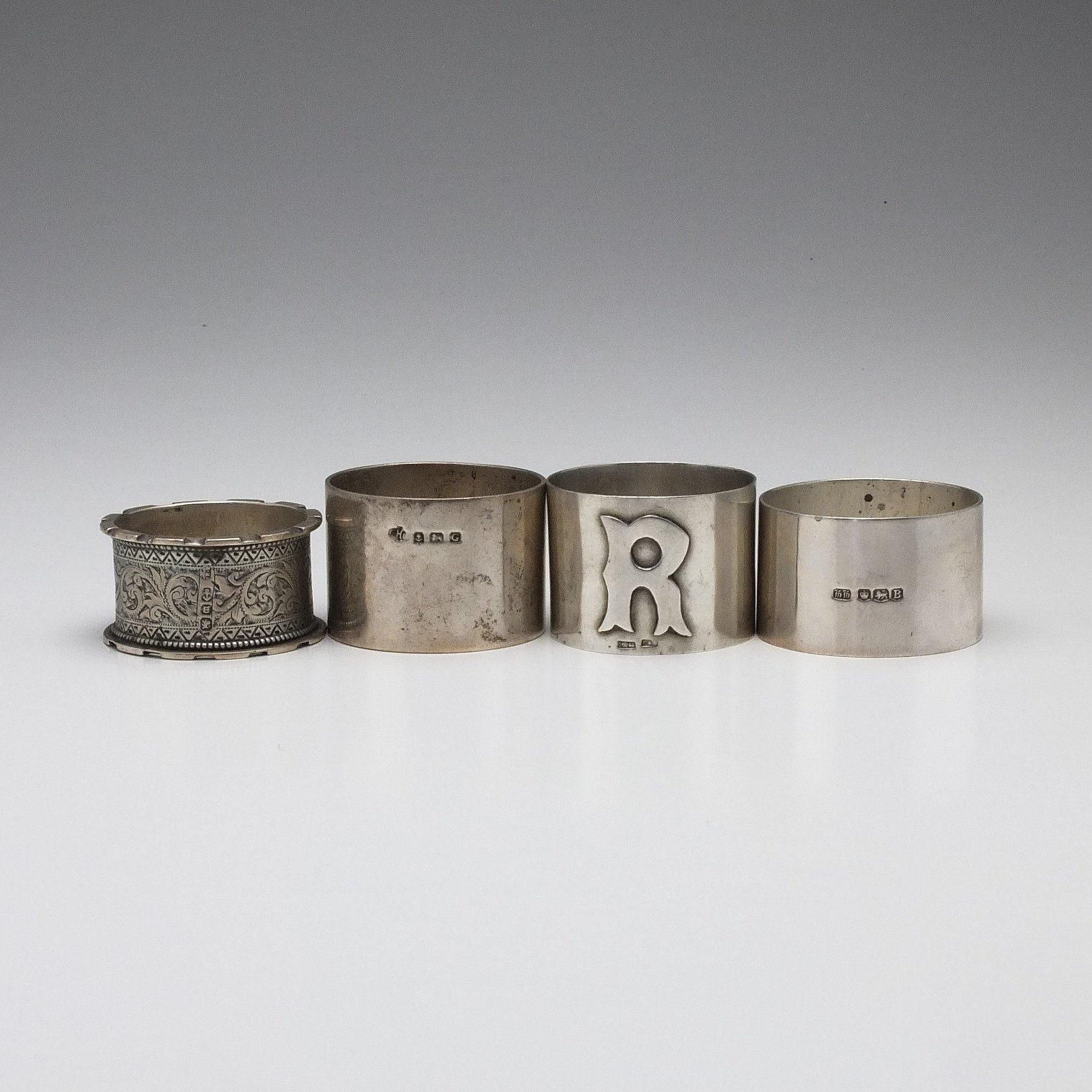 'Four Various Sterling Silver Napkin Rings, Including William Hutton & Sons Ltd Birmingham 1931'