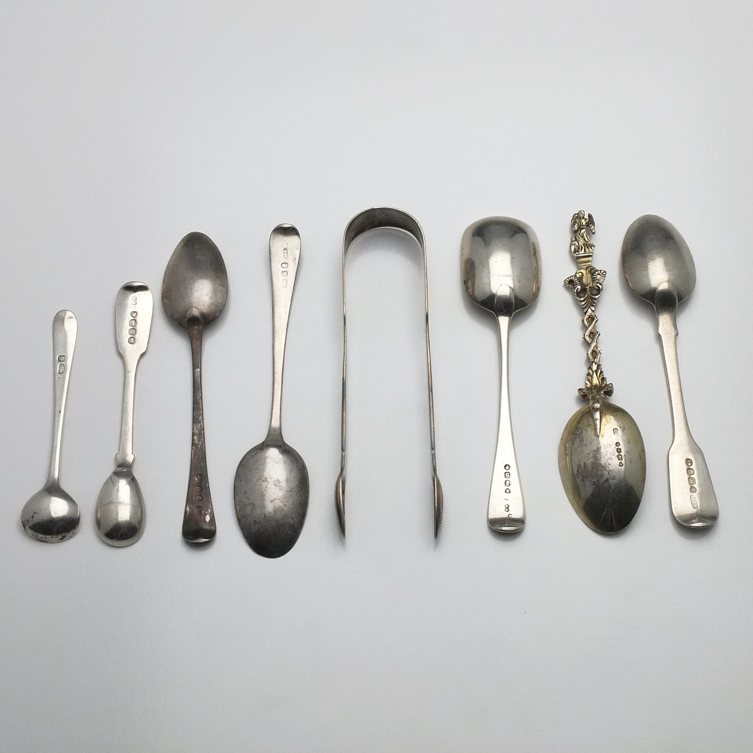 'Crested Sterling Silver Pair of Sugar Tongs, Five Sterling Teaspoons and Two Sterling Condiment Spoons'