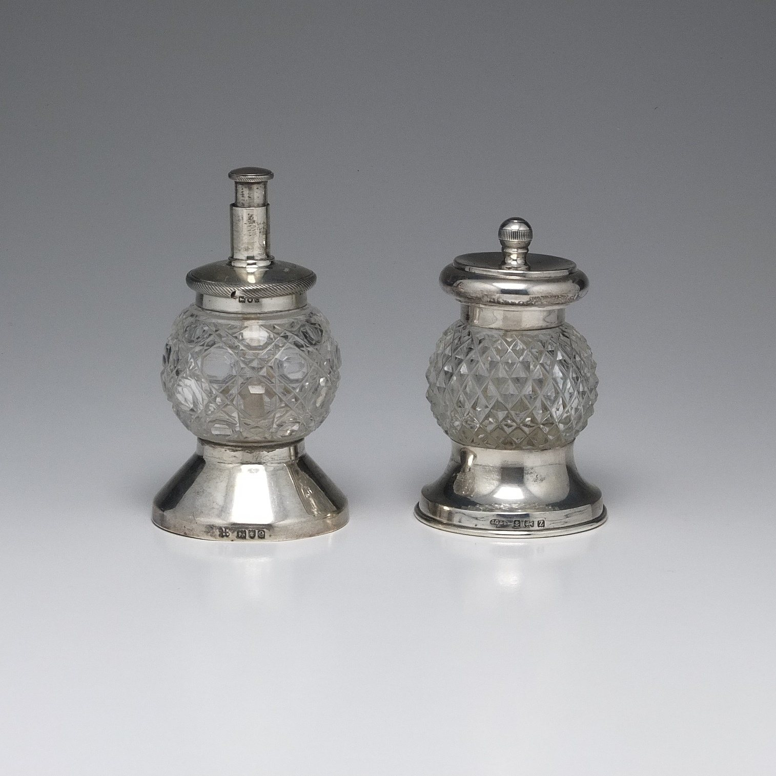 'Sterling Silver and Cut Crystal Salt and Pepper Set Hukin & Heath London 1900 and John Grinsell & Sons Birmingham 1924'